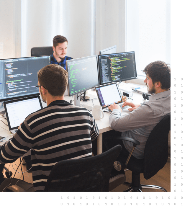 A group of employees working on migrating the client's full application layer