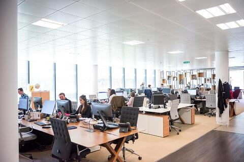Sustaining SAP and Cloud Transformation: Why a modern Managed Service is required - image of open plan office