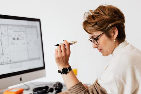 woman at a desk (3 SAP/Azure market place trends you need to know about blog)